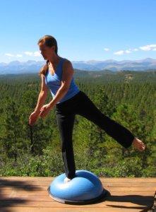 Bosu Ball, standing balance on right leg and another out wide to the side.