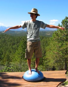 Trying to stand balanced with arms out on the Bosu Balance Trainer