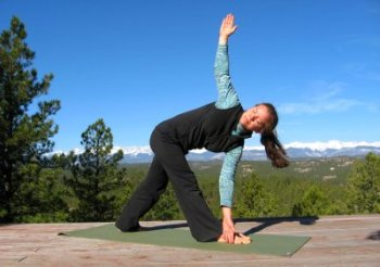 Revolved Triangle Pose, with a view of the Sangre de Cristo Mountains, CO