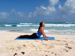 Cobra Pose, yoga pose at a beach near Playa del Carmen, Mexico