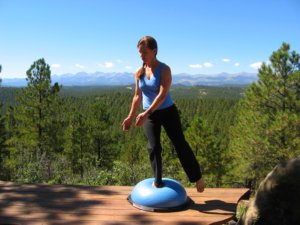 Bosu Balance Trainer, standing on one leg with a twist to right.