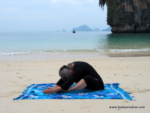 Deep Yin Yoga Position, Butterfly Pose on Pranang Beach, Railay, Thailand