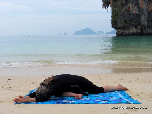The Sleeping Swan Yin Yoga Pose on Pranang Beach, Railay, Thailand