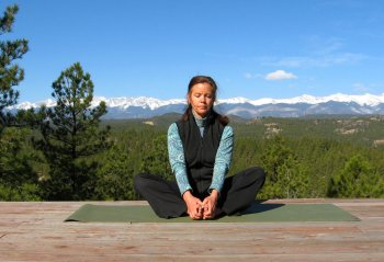 Seated Bound Angle Yoga Pose with a view of the Sangre de Cristo Mountains, Colorad