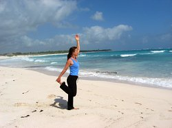 Modified Dancer's Yoga Pose at a beach near Playa del Carmen, Mexico