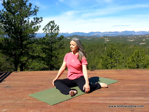Photo of Elle Bieling doing Deer Pose in Yin Yoga