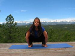 Garland Pose, yoga pose with a vew of the Sangre de Cristo Mountains, Colorado