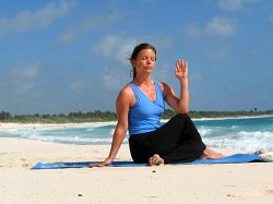 Half Spinal Twist Pose on a beach near Playa del Carmen, Mexico