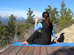 Half Spinal Twist yoga pose, with view of Spanish Peaks, Colorad