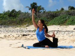 Modified Pigeon yoga pose at a beach near Playa del Carmen, Mexico