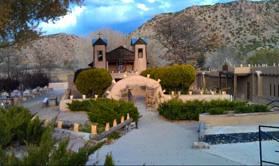 Holiday luminarias line the walls of El Santuario de Chimayo, Santa Fe, NM