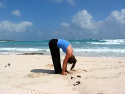 Standing Forward Bend at Playa del Carmen Beach, Mexico