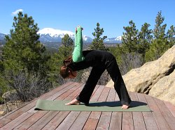 Intense Chest Stretch with arms in Dukha position, West Spanish peak in backgroun