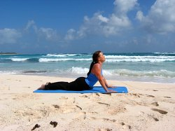 Upward Dog Pose, yoga pose at a beach near Playa del Carmen, Mexico