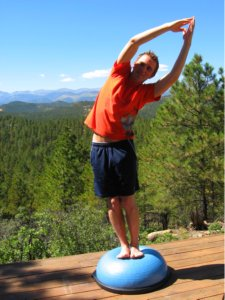 Standing Side Bend to Left with Hands Over Head on the Bosu Ball
