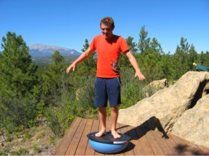 Standing on the Bosu Ball as a Wobble Board