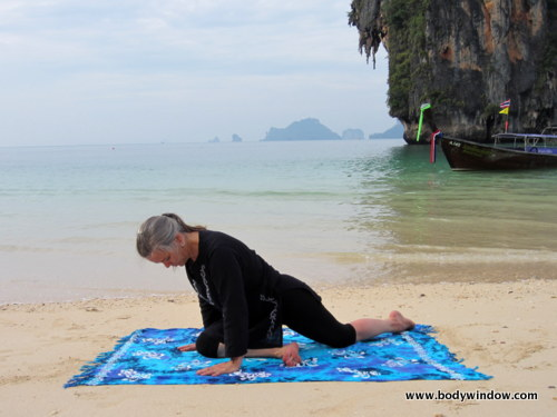 Beginning Pigeon Pose on Pranang Beach, Railay, Thailand