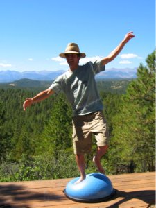 Trying to stand balanced on the Bosu Balance Trainer