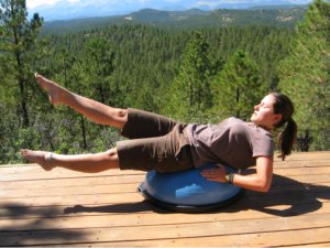 Bosu Ball, back lying extension with one leg up.
