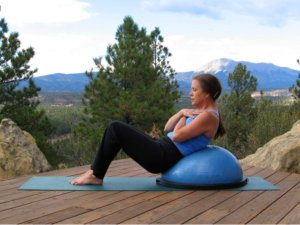 Classic Crunch in up position on the Bosu Ball