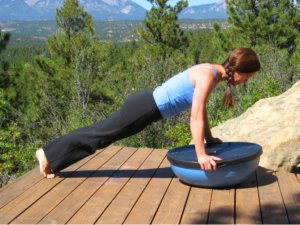 Bosu Balance Trainer, wobble side, push-up start position.
