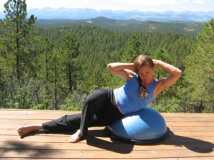 The side crunch, finishing position on the Bosu Ball.