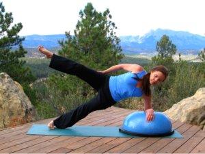 Bosu Balance Trainer, Side Plank Pose with leg raised.