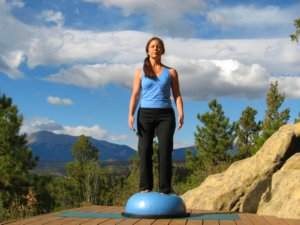 Standing Balance on Bosu Ball with eyes closed.