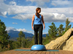 Standing on Bosu Ball, head turns to left