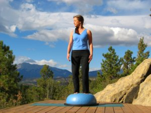 Standing on Bosu Ball, head turns right.