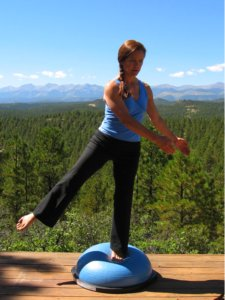 Bosu Ball, standing balance on left leg and another out wide to the side.