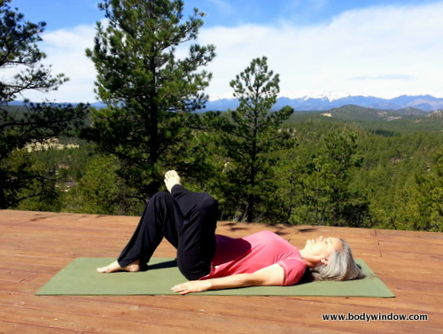 Eye of the Needle Pose, starting position, leg crosses over ankle. Sangre de Cristo Mountains of Southern Colorado.