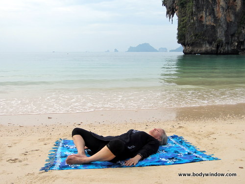 Lying Butterfly Pose, in Yin Yoga. Starting Position for the Fish Pose, Pranang Beach, Railay, Thailand