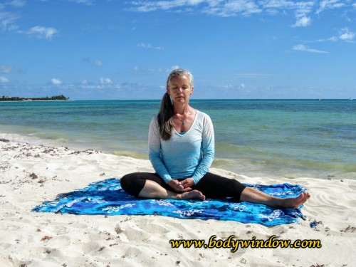 Half Dragonfly Pose Starting Position on a beach in Playa del Carmen Mexico