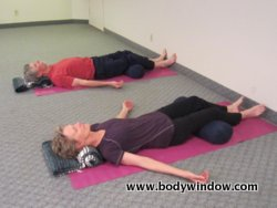 using a yoga bolster  restorative yoga to relax and renew