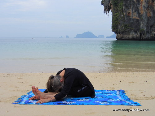 Photo of Elle Bieling doing Seated Forward Bend Pose, Pranang Beach, Railay, Thailand