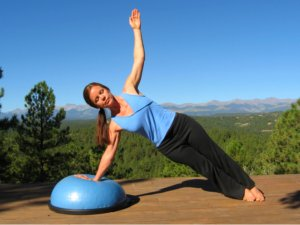 Yoga Side Plank Pose on the Bosu Ball.