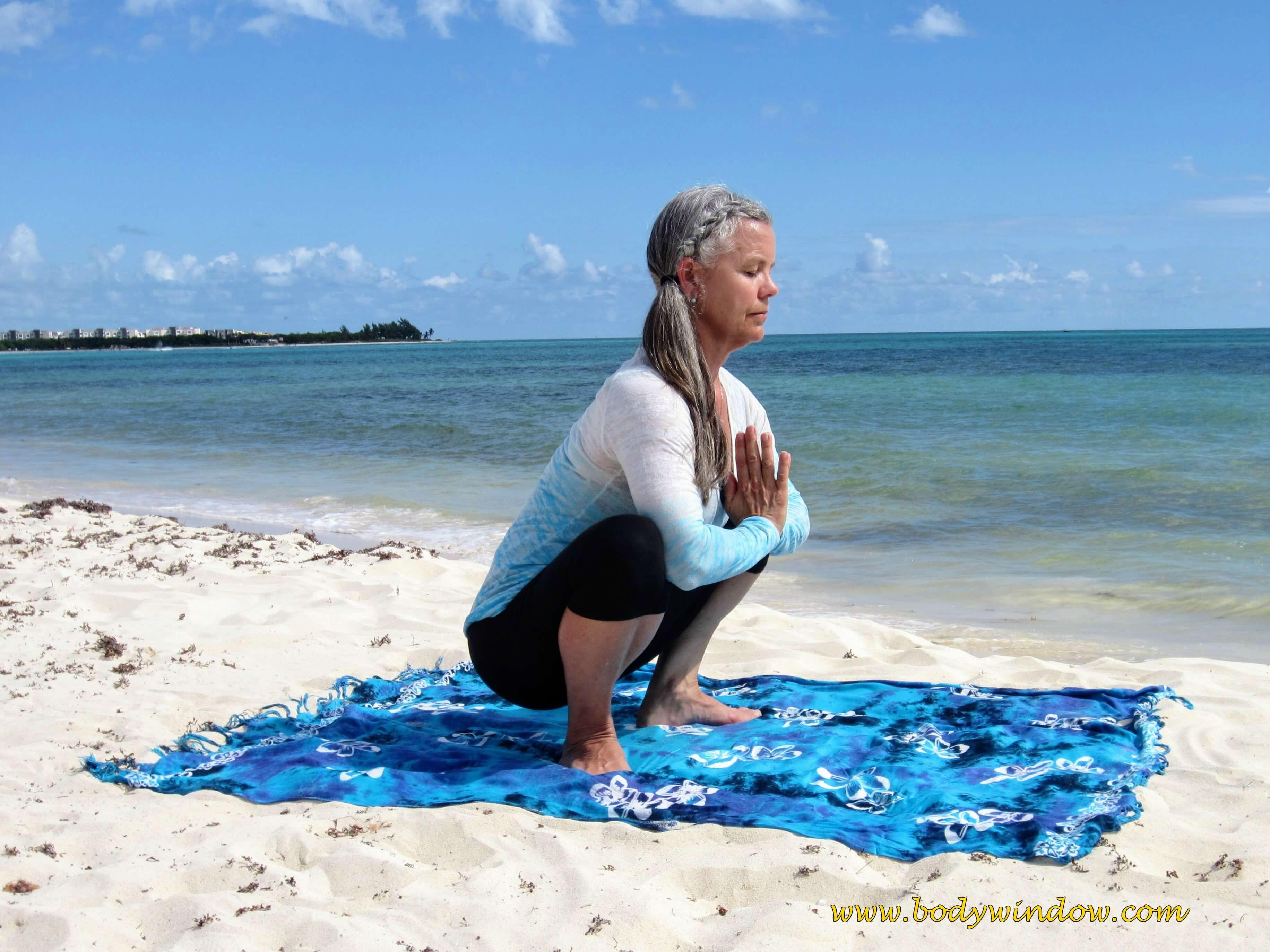 Squat Pose on a beach in Playa del Carmen, Mexico.