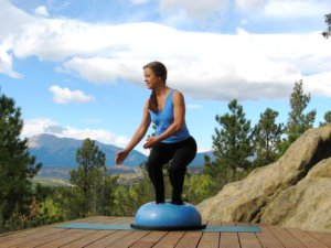 Bosu balance trainer, twisting squat, right.