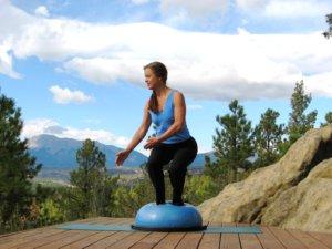 Bosu balance trainer, twisting squat, right.