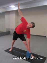 Triangle Pose with Yoga Block Inside Foot