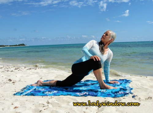 The Twisted Dragon Yoga Pose, Playa del Carmen beach.