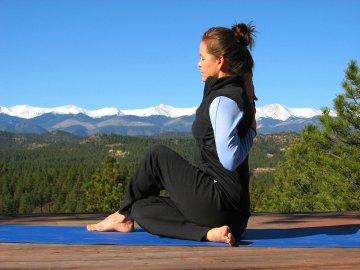 Yoga Cow-Faced Pose with Sangre de Cristo Mountain