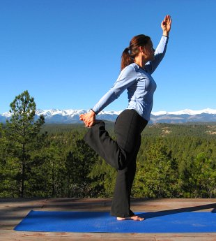 Modified Dancer's Pose, with a view of the Sangre de Cristo Peaks
