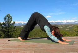 Downward Dog yoga pose, Sangre de Cristo mountain view, Colorad