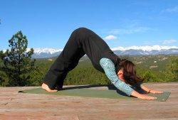 Downward Dog yoga pose, Sangre de Cristo mountain view, Colorad