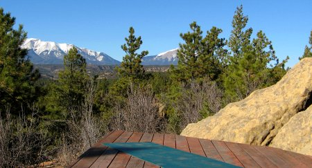 My yoga mat on my deck with a mountain view, my personal sacred space.