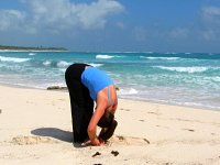 Standing Forward Bend Pose on the beach at Playa del Carmen, Mexico