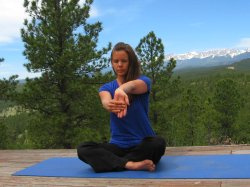 Wrist Extensor Stretch, palm away from body, with view of Sangre de Cristo mountains, Colorado