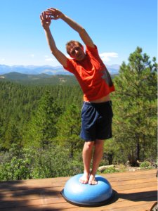 Standing Side Bend to Right with Hands Over Head on the Bosu Ball